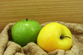 Yellow and green apple on fabric. — Stock Photo
