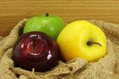Three color apple on fabric. — Stock Photo