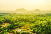 Sunset at the mountains and forests in the rainy season. — Stock Photo