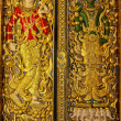 Gold carved ancient door of temple Thailand. — Stock Photo #39433421