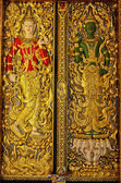 Gold carved ancient door of temple Thailand. — Stock Photo