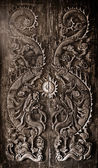 Antique wooden door, Sculpt a Dragon God. — Stock Photo