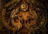 Antique wooden door, Sculpt a Dragon God. — Stock Photo