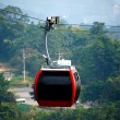Red cable car, Go to mountain. — Stock Photo #39488353
