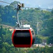 Red cable car, Go to mountain. — Stock Photo #39488369