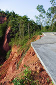 Road damage from the landslide — Stock Photo