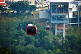 Red cable car, Go to the mountain. — Stock Photo