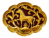 Wooden carved animals, painted gold. — Stock Photo