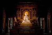 White Buddha in wood church. — Stock Photo