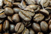 The macro of roasted coffee beans. — Stock Photo