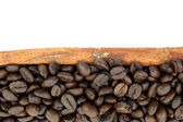 Roasted coffee beans and cinnamon — Stock Photo