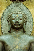 Asian religious art. Ancient green stone sculpture of Buddha at  — Stockfoto