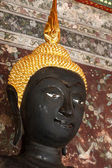 Black buddha ancient  in temple, Thailand. — Stock Photo