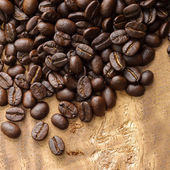 Coffee on wooden background — Stock Photo