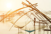Silhouette of traditional fishing method using a bamboo square d — Stock Photo