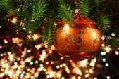 Christmas Tree Bauble on luminous background — Stock Photo