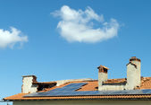 Solar pannels on a rooftop — Stock Photo