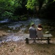 Royalty-Free Stock Photo: Couple next to a river