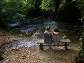 Couple next to a river — Stock Photo