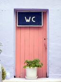 Porte des toilettes rose — Photo