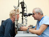 Ophthalmologist examines elderly — Stock Photo