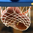 Stock Photo: Basketball hoop with ball