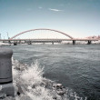 River with bridge, infrared — Stock Photo