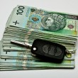 Car keys on a generous pile of money — Stock Photo