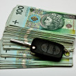 Stock Photo: Car keys on generous pile of money