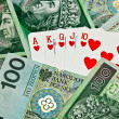 Street poker cards and money — Stock Photo