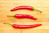 Three red chili peppers — Stock Photo