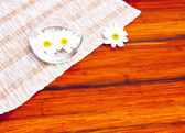 Flowers in the water and wipe the wood — Stock Photo