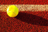 Tennis ball near the out line — Stock Photo