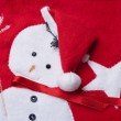 Stitched snowman on a red christmas sock. — Stock Photo