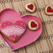 Heart-Shaped Cookies in a Pink Box on an wooden pad. — Stock Photo
