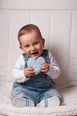 Baby boy holding a stuffed heart — Stock Photo