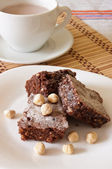 Delicious Chocolate Brownie and Hazelnuts with cocoa milk — Stock Photo
