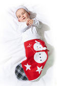 Baby in a christmas sock. — Stock Photo