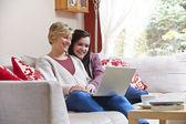 Mother and daughter on laptop — Stock Photo