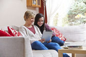 Mother and daughter on tablet computer — Stock Photo