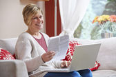 Woman doing home banking — Stock Photo