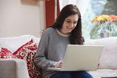 Teenage girl on laptop — Stock Photo