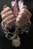 Businessman in chains — Stock Photo