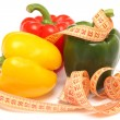 Peppers with a measuring tape — Stock Photo #16262865