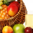 Fruits in basket and juice. - Stock Photo