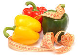 Peppers with a measuring tape — Stock Photo