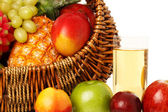 Fruits in basket and juice. — Stock Photo