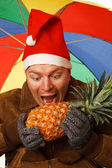 Man with pineapple. — Stock Photo