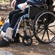 Young man in a wheelchair — Stock Photo