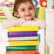 Laughing girl with books — Stock Photo